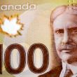 Detail of the Canadian 100 dollar bill, featuring the face of Sir Robert Borden (1854-1937), who was prime minister of Canada during World War I (1914-1918). The current bank notes are made from a polymer plastic paper.
